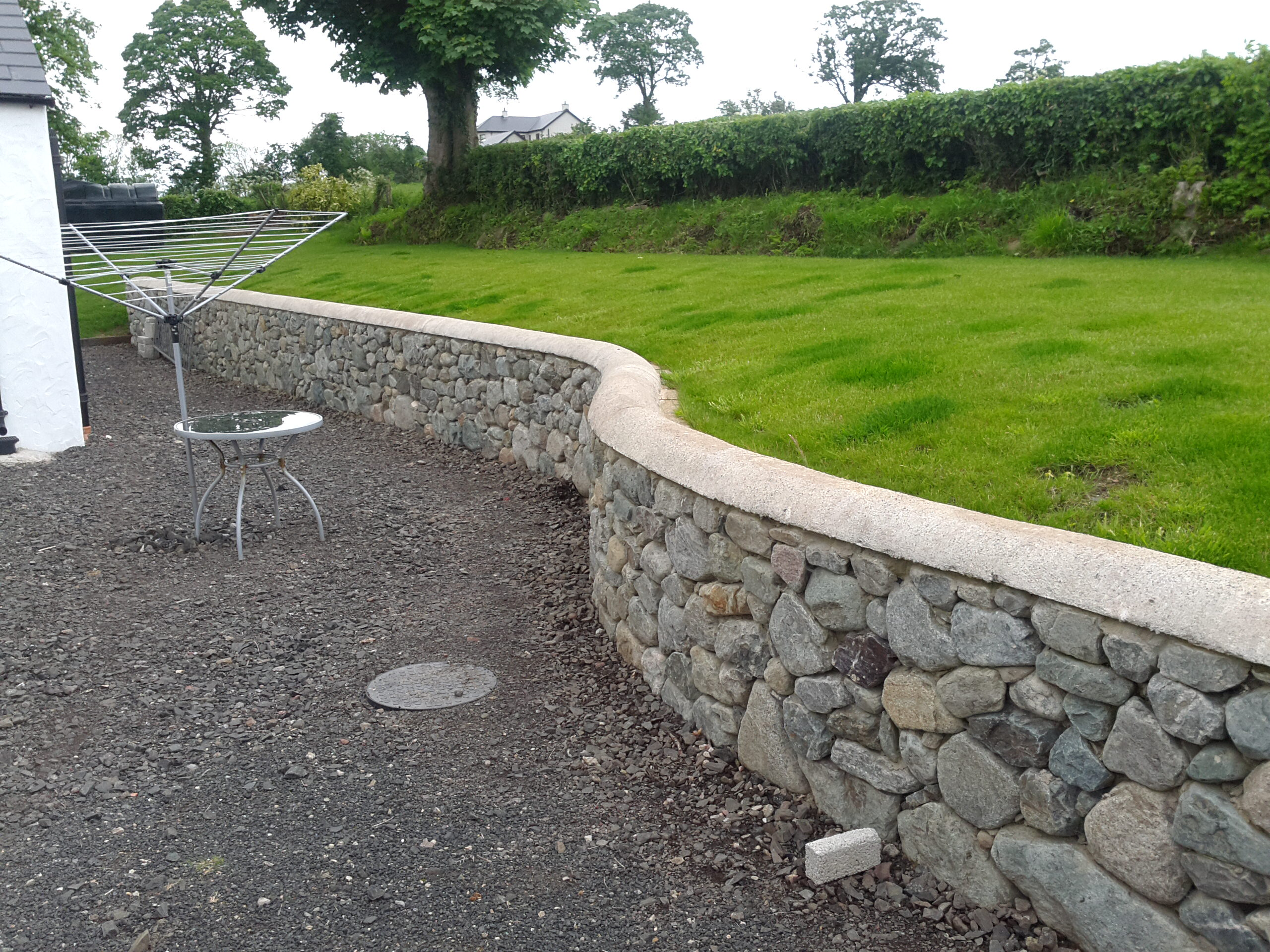 Granite Stone Walls : D law son retaining wall built from granite pit stone